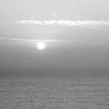 Cloudy sunrise (sunset) at sea Stock Photography