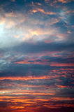 Cloudy sunset Stock Images