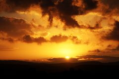 Cloudy sunset above desert mountains royalty free stock photography