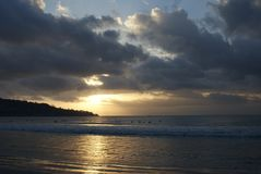 Cloudy sunset in Bali. Sun setting below clouds in Bali Stock Images