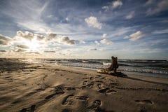 Cloudy sunset. Cloudy beach in karwienskie blota Stock Photo