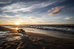 Cloudy sunset. Cloudy beach in karwienskie blota Stock Images