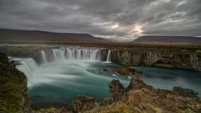 Cloudy Sunset at Godafoss, Northeastern Iceland. The Goðafoss is a waterfall in Iceland. It is located in the Bárðardalur district of Northeastern royalty free stock photography