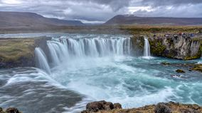 Cloudy Sunset at Godafoss, Northeastern Iceland. The Goðafoss is a waterfall in Iceland. It is located in the Bárðardalur district of Northeastern royalty free stock photos