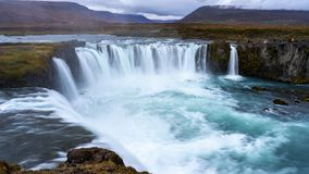 Cloudy Sunset at Godafoss, Northeastern Iceland. The Goðafoss is a waterfall in Iceland. It is located in the Bárðardalur district of Northeastern royalty free stock images