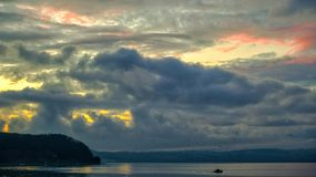 Bracciano lake on sunset stock photos