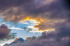 Cloudy sunset lights. In the sky of Reunion island stock photography