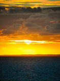 Cloudy sunset in the ocean. Stock Photography