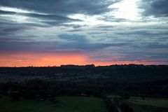 Sunset over Forest. Cloudy Sunset over Green Forest Stock Image