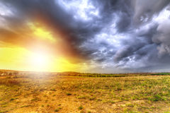 Cloudy sunset over the meadow Royalty Free Stock Photography