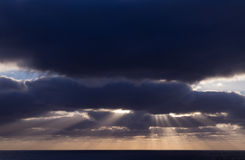 Cloudy sunset over ocean Royalty Free Stock Photo