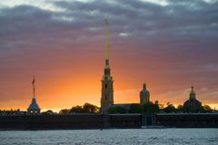 A cloudy sunset over the Peter and Paul Fortress. Saint-Petersburg, Russia. A cloudy sunset over the Peter and Paul Fortress. Saint Petersburg, Russia stock photography