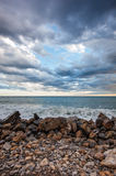 Cloudy sunset over sea Stock Image