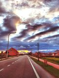Cloudy Sunset over the street Stock Images