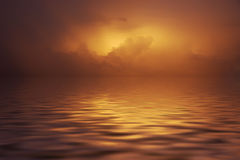 Cloudy sunset over water. Eerie cloudy sunset and reflection on the ocean Royalty Free Stock Image