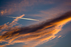 Cloudy Sunset Sky With Airplane Stock Image