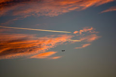 Cloudy Sunset Sky With Airplanes Stock Photo