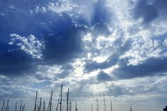 Cloudy sunset sky with sailboat mast Royalty Free Stock Images