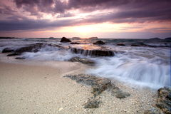 Cloudy sunset in Sutera harbour beach. Royalty Free Stock Photo