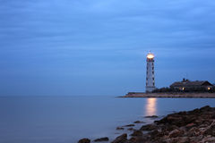 Cloudy twilight seascape with lighthouse Royalty Free Stock Photos