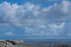 Cloudy waterfront. Clouds over waterfront in Baracoa, Cuba Royalty Free Stock Photo