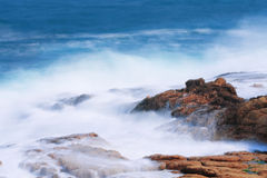 Cloudy wave. A cloudy wave is along the coast Stock Image