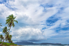 Cloudy weather on the tropical coast Royalty Free Stock Photo