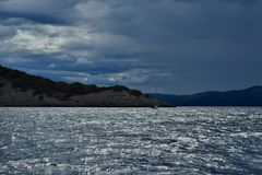 Cloudy weather and wavy sea royalty free stock photo