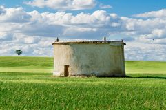 Cloudy wheat Field and Dovecote Stock Photos