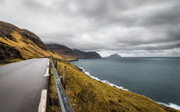 Cloudy And Windy Evening View of Road, Ocean and island in The Horizon. Faroe islands, Denmark,Europe Stock Image