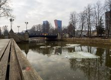 Cloudy winter day on a river with floating ice floes overlooking high-rise buildings and Exchange Bridge in the central part of royalty free stock photos