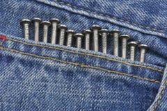 Clous à l'intérieur de poche de jeans Image stock