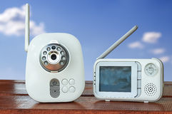 The clouse-up baby monitor. For security of the baby . Blue sky behind Royalty Free Stock Photography