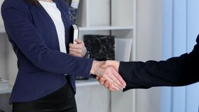 Clouse-up of businessman and businesswoman shaking hands.  stock footage