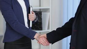 Clouse-up of businessman and businesswoman shaking hands.  stock video footage