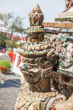 Clouse up of Demon Guardian statue at Wat Arun temple in Bangkok. Close up of demon guardian statues decorating the Buddhist temple Wat Arun in Bangkok, Thailand Stock Image