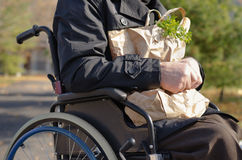 Clouse up handicapped man doing his grocery shopping stock photography