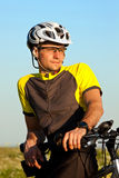 Clouse up portrait of mountain biker. Portrait of mountain biker in the meadow Stock Photos