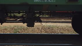 Clouse up Freight train wheels. Clouse up riding Freight train wheels stock footage