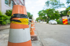 Clouse-up a traffic cone on the road with blur background Royalty Free Stock Images