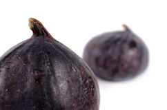 Clouse up two delicious ripe fresh purple figs Royalty Free Stock Photos