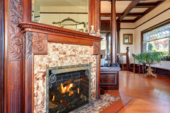 Clouse up view of antique fireplace with decorative tile trim. Stock Images