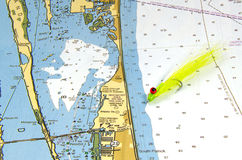 A Clouser Fly on a Nautical Chart Stock Photography