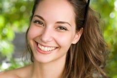Clouseup portrait of a friendly brunette. Clouseup portrait of a beautiful  friendly young brunette woman Stock Photo