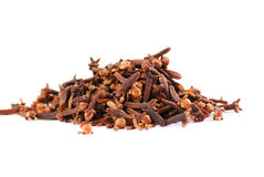 Clove. Brown colour and laid out by a hill on a white background Royalty Free Stock Images