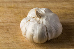 Clove garlic peel on a  board Royalty Free Stock Photography