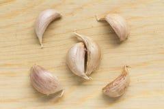 Clove of garlic. Garlic clove on wood chopping block Royalty Free Stock Photos