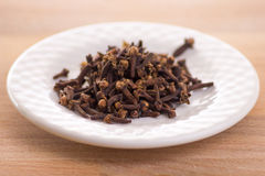 Clove. Herb  in white plate Stock Image
