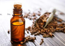 Clove oil. In glass bottles and on a table royalty free stock photo