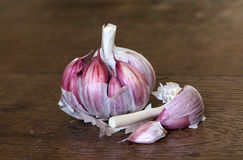 A clove of organic garlic on a wooden table. Cooking ingredient Royalty Free Stock Photos